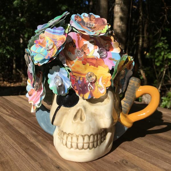 Peter Pan little golden book hand-cut paper flower arrangement in skull mug vase