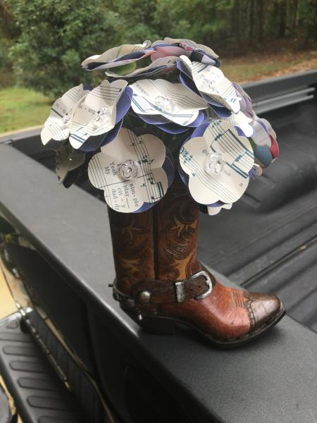 "Music Sheet ""Thank God I'm a Country Boy"" hand-cut paper flower arrangement in Cowboy boot vase"