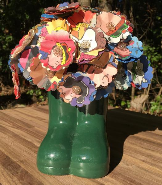 Charlie Browns Christmas hand-cut paper flower arrangement in boots vase