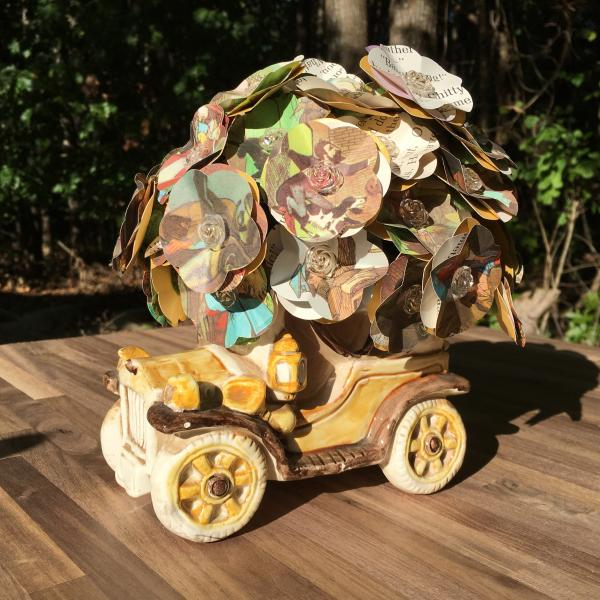 Chitty Chitty Bang Bang little golden book hand-cut paper flower arrangement in vintage mini car vase