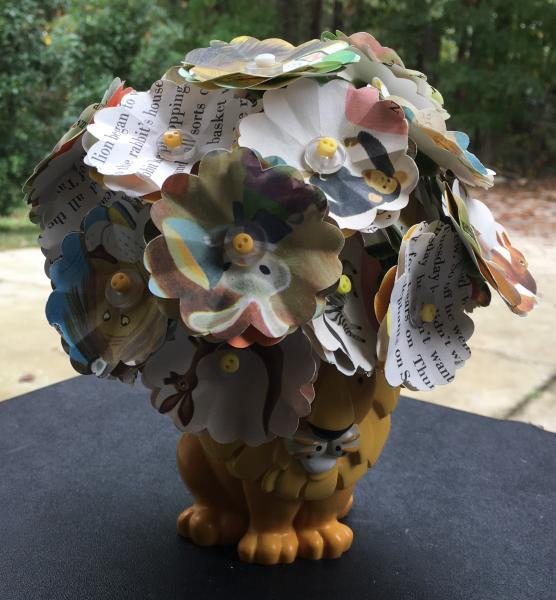 Scrawny Tawny Lion little golden book hand-cut paper flower arrangement in lion 'vase'