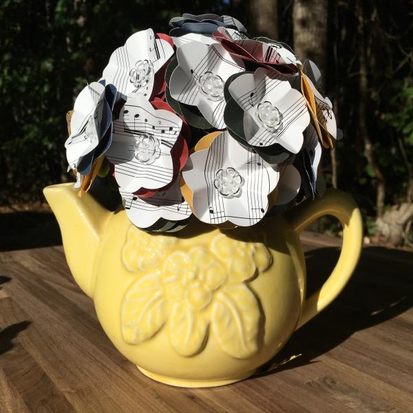 Music sheet Hedwig's theme hand-cut paper flower arrangement in Hufflepuff yellow teapot