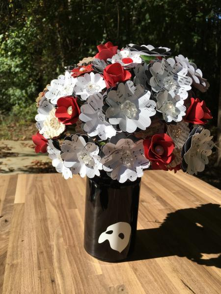 "Phantom of the Opera Arrangement. Music sheet 'All I ask of you"" plus flowers cut from the novel, plus rosebuds, plus color highlights hand-cut paper flower arrangement in vase"