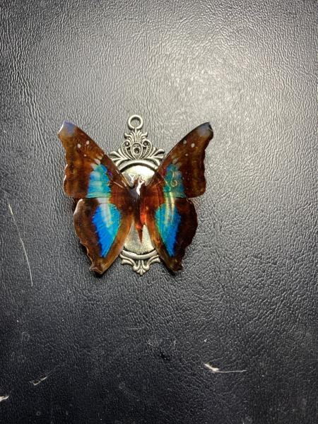 Black and blue butterfly pendant