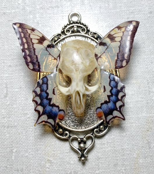 Swallowtail butterfly and vole skull pendant