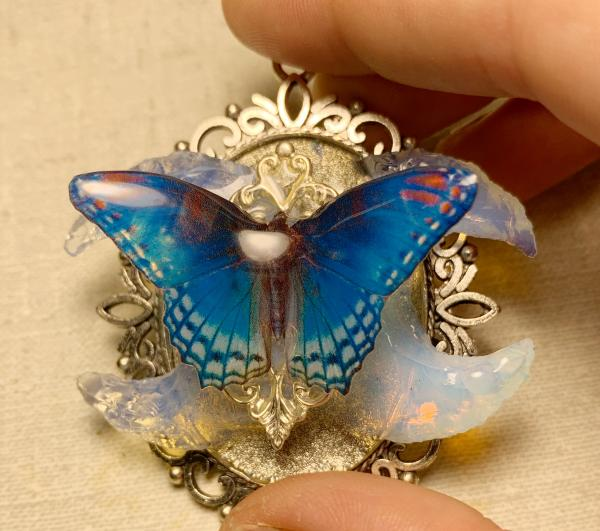 Bridal blue butterfly with opalite crescent moons pendant