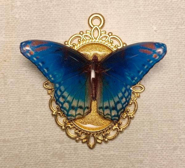 Blue butterfly on gold plated pendant