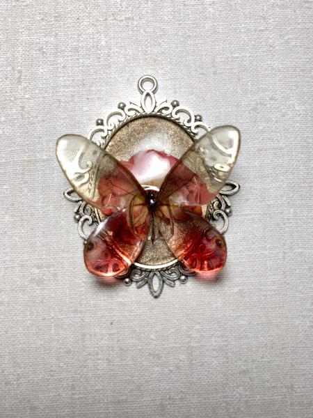 Glasswing butterfly with real flower pendant