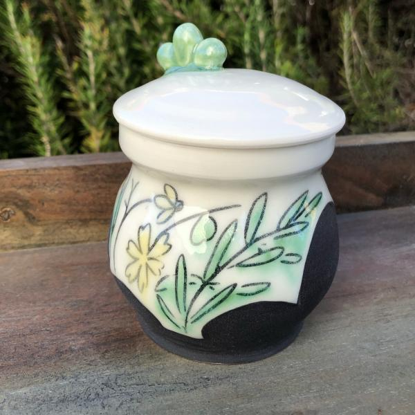 green and yellow herb jar