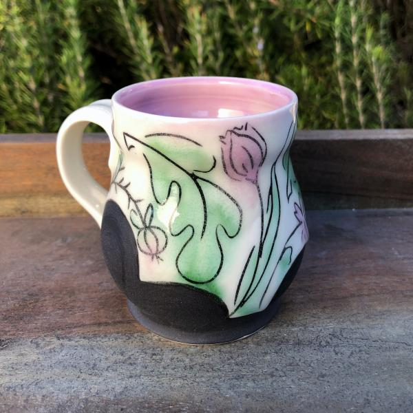 pink and green floral teacup