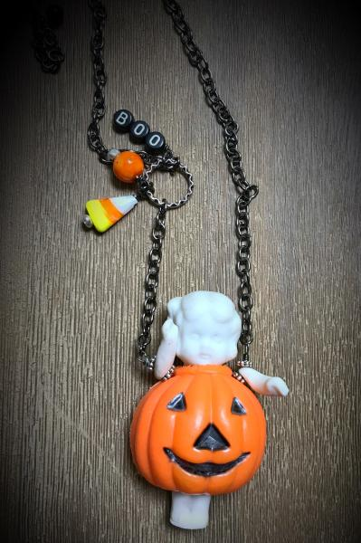 Pumpkin vintage doll necklace