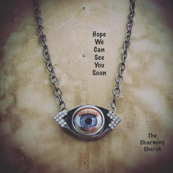 Blinking doll eye necklace
