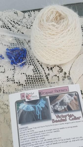 This is a kit to create this knitted lace beaded collar. (The knitted example is a different color from the yarn in this kit.) The collar can be worn picture