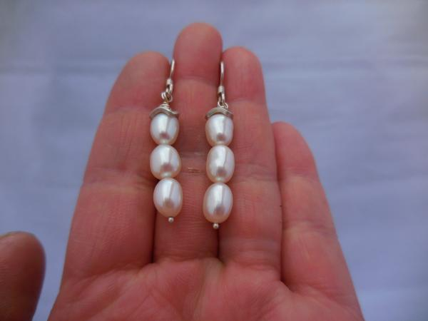 Three freshwater white pearls with argentium cap LY E 6976