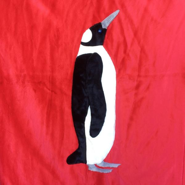 Emperor Penguin on Red Applique Blanket picture
