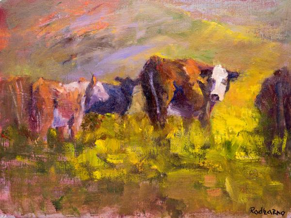 Cows Grazing on Green Pastures