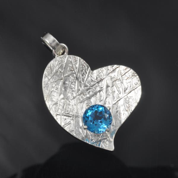 Sterling silver frost pattern heart with blue topaz gemstone