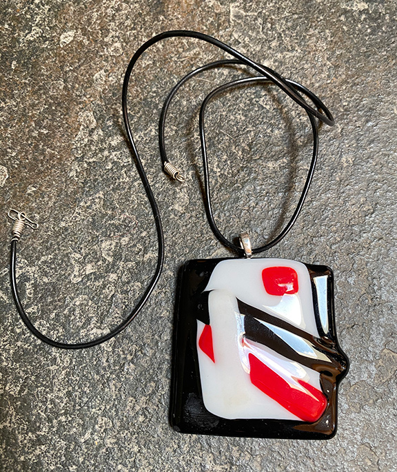 Black red and white glass pendant