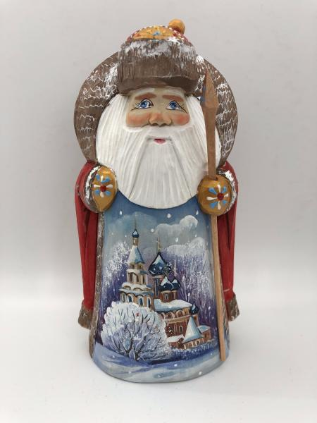 Santa Figure with the Christmas Tree and Church picture
