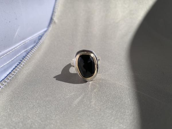 Black onyx, sterling and 14k yellow gold ring.
