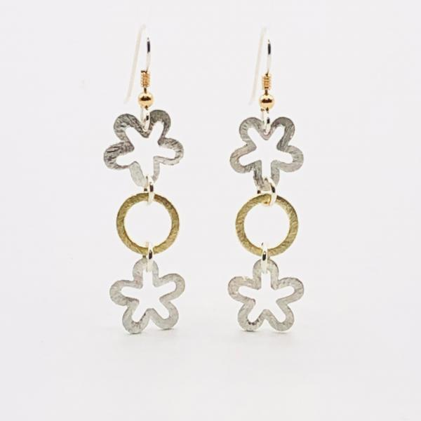 Interconnecting flower and circle dangle earrings in silver/gold, sterling silver ear wires. Elegant, sexy & lightweight. By DianaHDesigns