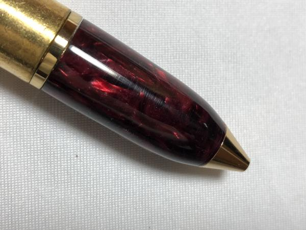 50 caliber machine gun bullet pen made with various acrylics, gold hardware, and a genuine casing picture