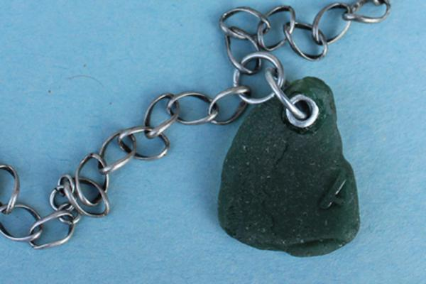 N502 Riveted Green Beach Glass