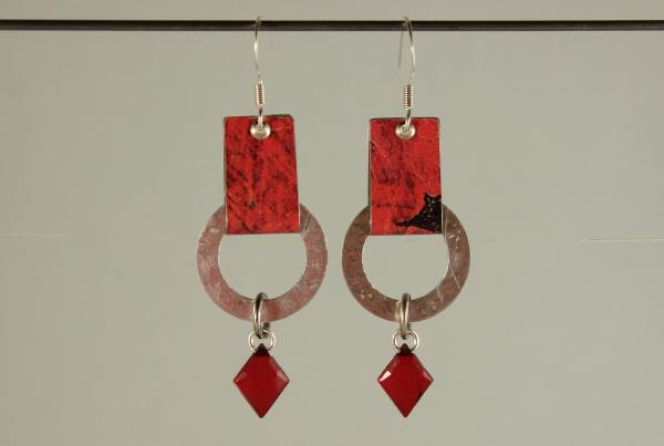 E426 Riveted Tin Loops & Red Crystal