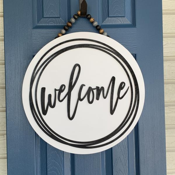 Welcome round Door sign With scribble circle picture