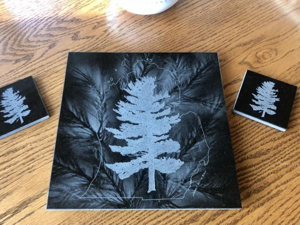 Etched White Pine within Michigan outline on granite lazy Susan hot plate