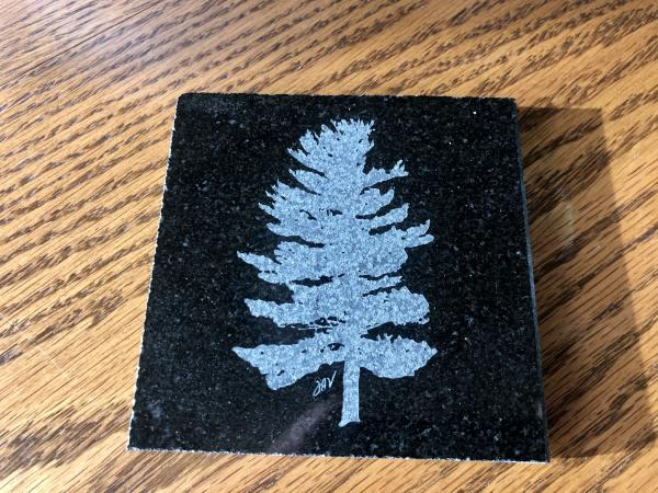 Etched white pine drink coaster or tile and polished granite