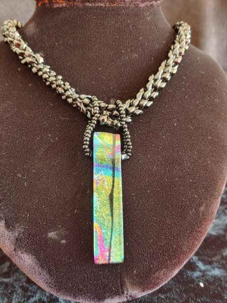 Dichroic pendant with beaded rope.