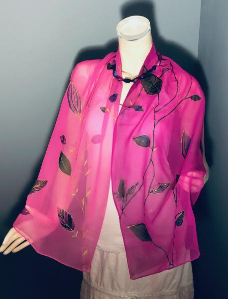 Hand Painted leaves embellished with gold resist on georgette scarf with pink background