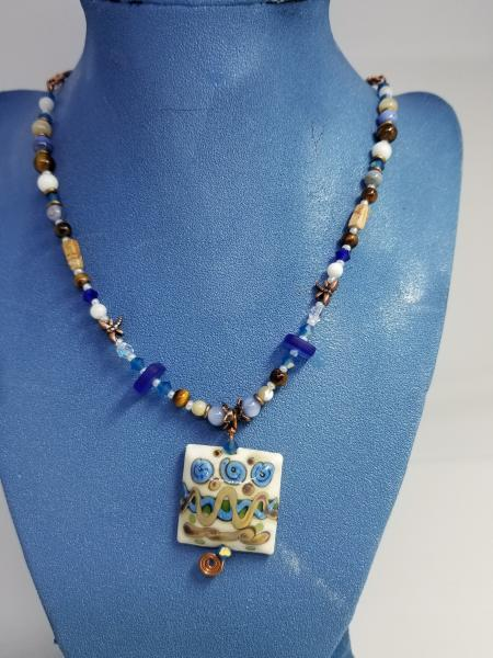 Blue Flowers in Ivory field pendant picture