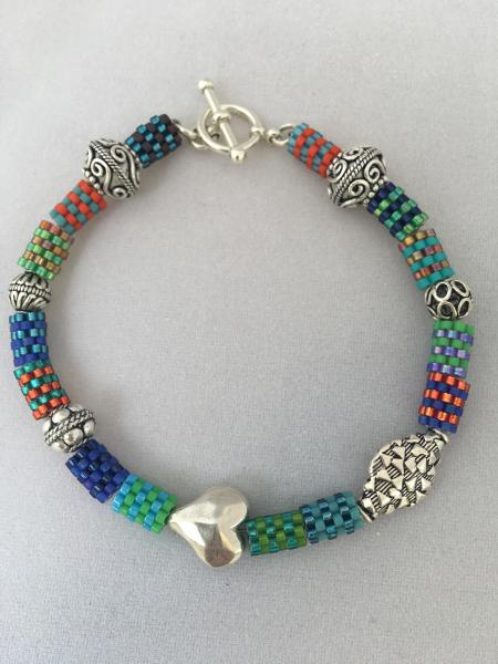 Beaded bead and sterling silver bracelet